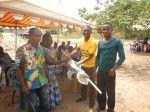 Joshua Nsiah, GWASH BCC Agent for Volta Region, presents prizes to leaders of ODF communities.
