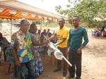 Joshua Nsiah, GWASH BCC Agent for Volta Region, presents prizes to leaders of ODF communities.