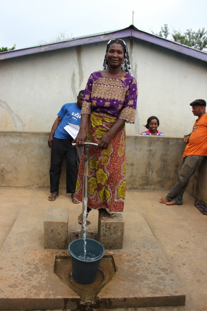 In the remote rural community of Cornerboy, in Ghana's Assin North District, community members demonstrate how they are using and maintaining their repaired borehole.
